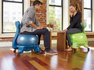 Playing A game with Gaiam Balance Ball Chair Stability ball chair & Top 7 Stability Ball Chair Reviews For Improved Health Posture ...